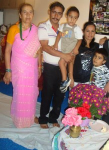 Darshan with his father and other family members : (Photo courtesy : Punam Mainali)